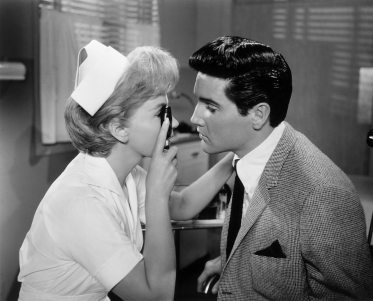Elvis Presley (1935 - 1977) and Joan O'Brien play nurse and patient in director Norman Taurog's film 'It Happened At The World's Fair'.  (Photo by Evening Standard/Getty Images)