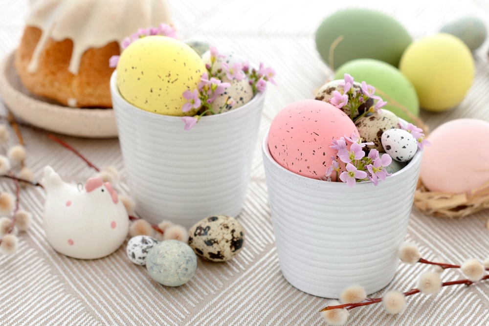 easter decor with easter eggs in white cups